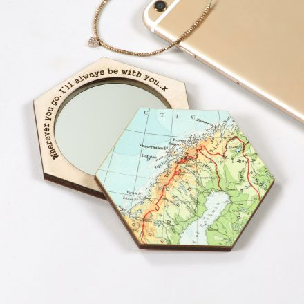 Hexagon shaped compact mirror featuring a map location of your choice with message engraved around mirror's edge.