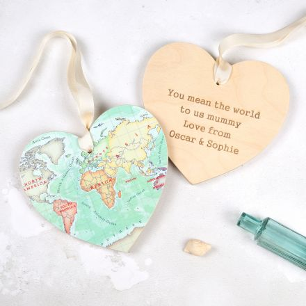 Wooden hanging heart, with pretty pastel world map on one side and personalised engraving on the other. Strung with white ribbon.