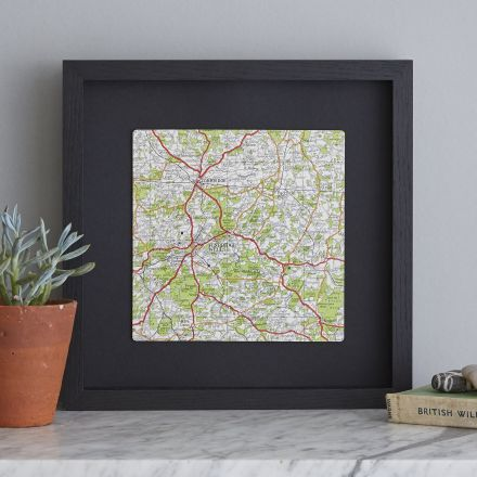 Map square mounted on black with black wood frame.