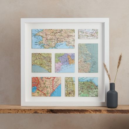 Eight personalised vintage map anniversary gift in light wood frame.