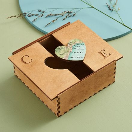 Handmade wooden keepsake box with map heart and initials engraved on top of box.