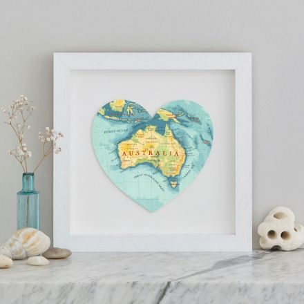 Blue, yellow and green map of Austtalia in a white box frame
