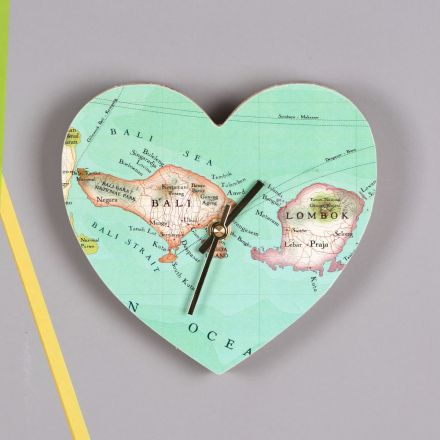 Heart shape wood clock faced in pretty map of Bali. Gold hands.
