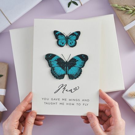 Blue handpainted and etched butterflies mounted on a mother's day card