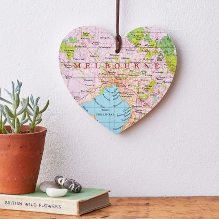 Personalised map location hanging heart. Melbourne map heart strung on leather cord hanging over mantelpiece