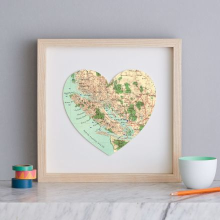 Vancouver map heart print with light wood frame.
