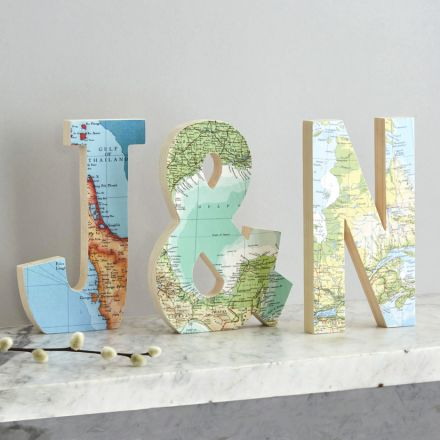 Set of three wooden letters featuring three different maps. 'J' '&' 'N'.