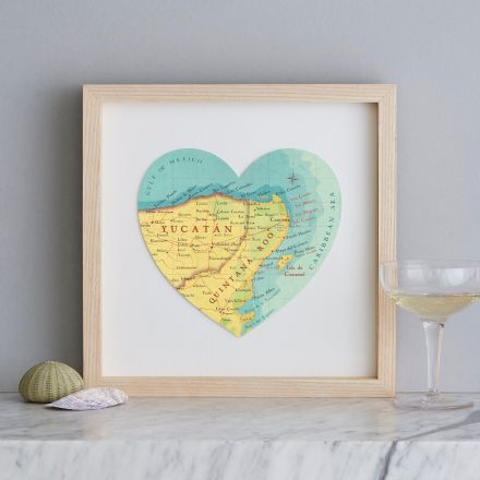 Framed map heart of Cancun, Mexico. Framed with a light wood box frame.