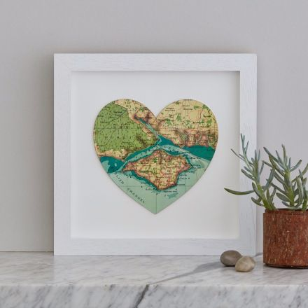 Isle of Wight map heart in white wood frame.