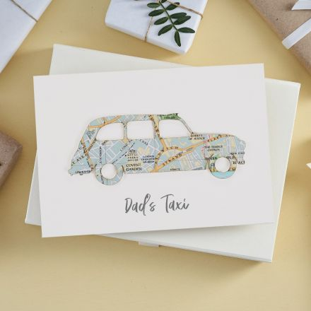 White card featuring a taxi silhouette cut from London map with 'Dad's taxi' printed beneath.