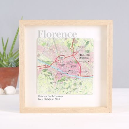 Square map of Florence mounted with 'Florence' printed above and birth details below. Light wood box frame.