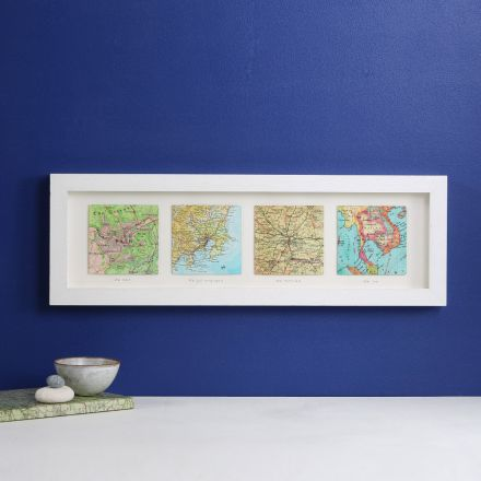 Three map hearts in a white frame, portrait orientation.  With printed personalisation 'we met' 'I proposed' and 'we married' printed in sequence under each heart.