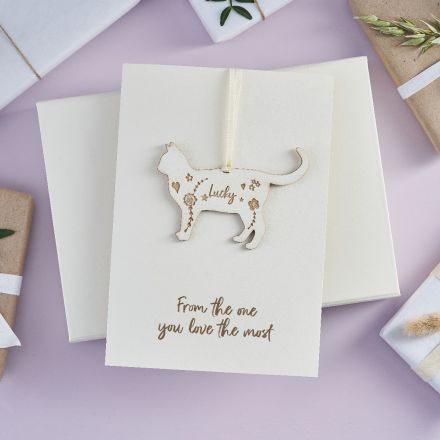 Pretty wooden cat keepsake strung on white greetings card printed with 'From the one you love the most'