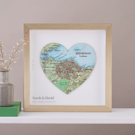 Map location heart in gold frame with printed personalisation.