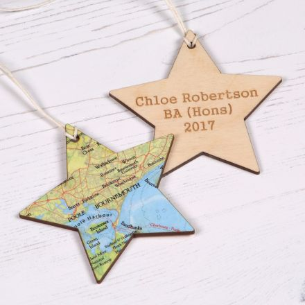 Hanging wooden star shaped keepsake with map on one side and engraving on the other.