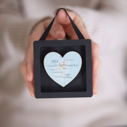 Miniature frame gift, black frame with small map heart. Strung with black ribbon.
