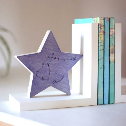 Wooden star sign constellation bookend.