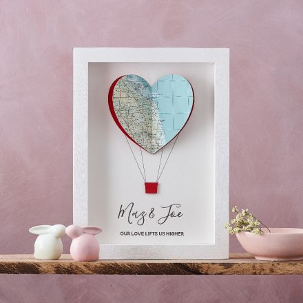 3D framed map artwork. Heart shape cut from map to make hot air balloon artwork with couples names and personalised message printed beneath. White wood box frame.