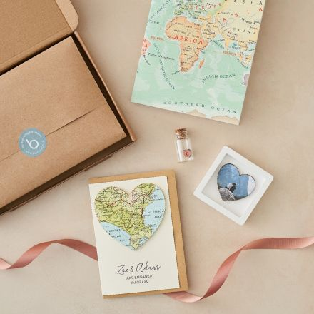 Engagement letterbox gift with map heart card, miniature heart photo frame and token glass message bottle.
