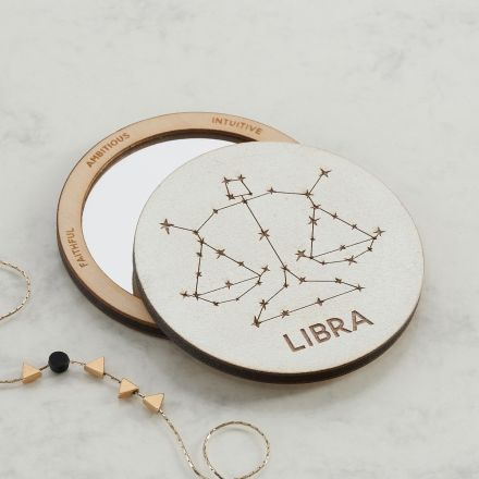 Handmade horoscope pocket compact mirror with engraving of star sign constellation on the mirrors back and star sign attributes engraved around mirror's edge.