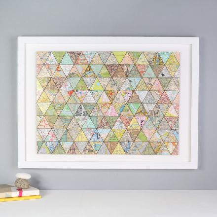 Triangles of London map made into patchwork framed in white box frame.