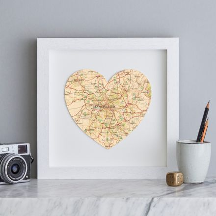 Map heart of Manchester in white box frame.