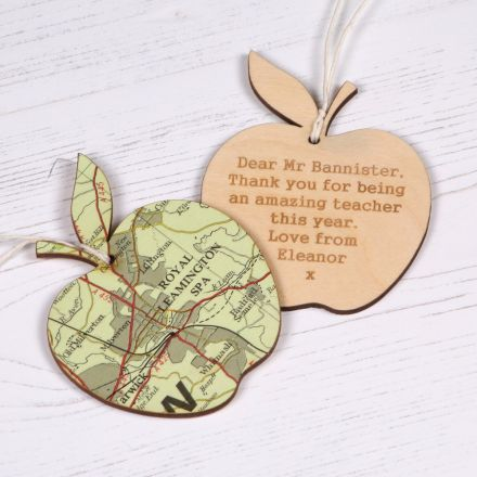 Two wooden map apples, one showing map side and the other showing reverse with personalised engraved message.