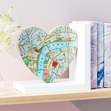 Solid wood heart shaped bookend faced in London map.