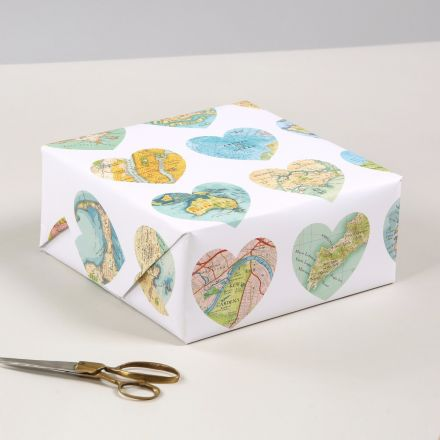 Gift wrap featuring large map hearts of destinations from all over the world.