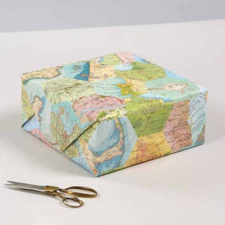 Patchwork map wrapping paper featuring locations from all over the world.