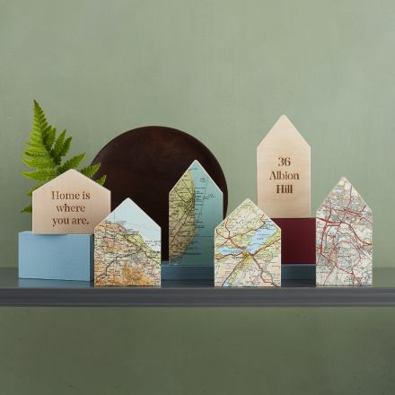 Miniature personalised map location house ornaments.