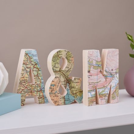 Set of three wooden letters featuring three different maps. 'A' '&' 'M'.