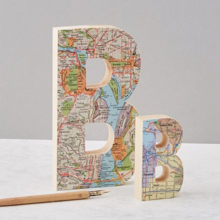 Two wooden letters featuring personalised map locations. One large 'B' one small 'B'.