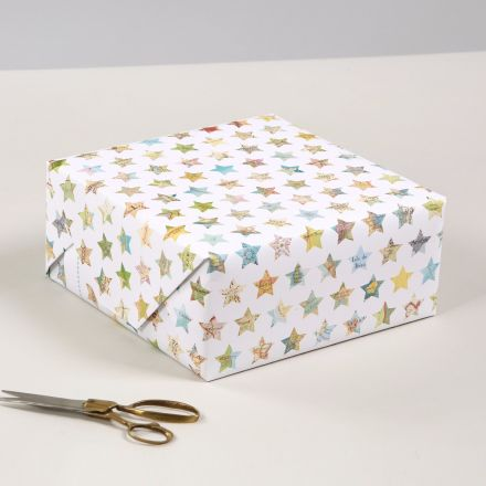 Luxury wrapping paper, white with small map stars of popular locations from all over the world.