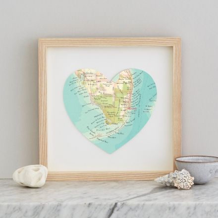 Miami map heart in light wood frame.