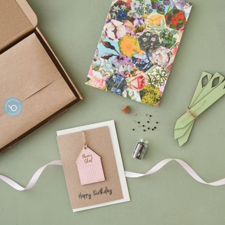 Letterbox gift for gardeners, shed keepsake card, seed markers, notebook and miniature bottle with seeds.