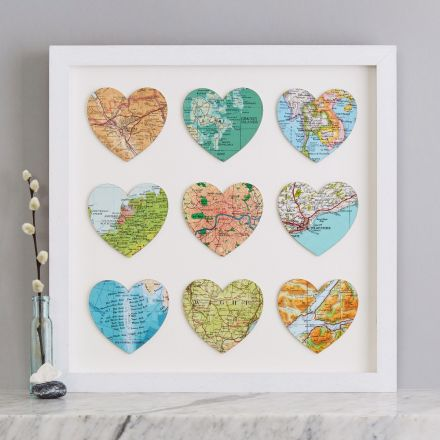 Nine map hearts in white wood frame.