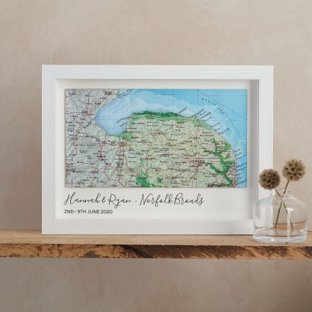 Landscape custom map of Norfolk, mounted on white card with 'Hannah & Ryan - Norfolk Borads, 2nd - 9th June 2020' printed beneath map. White wood frame.