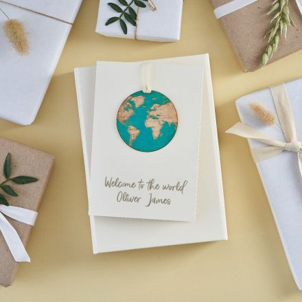 Engraved wooden cat keepsake strung on card printed with 'Hope you're feline better'
