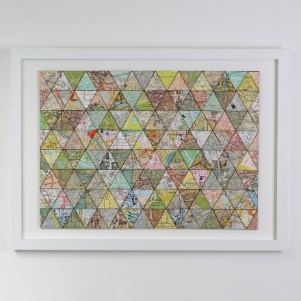 Map patchwork artwork in white box frame