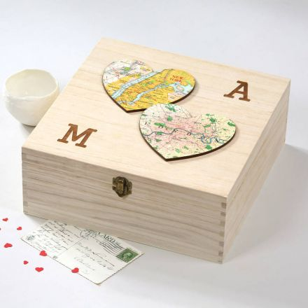 Wooden box with two map hearts on lid and engraved initials.