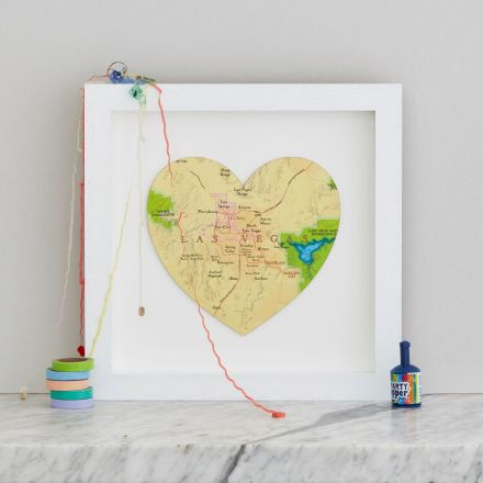 Map heart of Las Vegas with white wood frame.