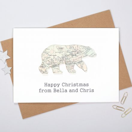 White card featuring map polar bear with printed message below reading 'Happy Christmas from Bella and Chris'