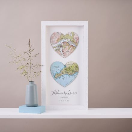 Two map hearts framed in white box frame, portrait orientation