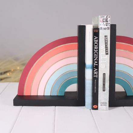 pastel rainbow solid wood bookend. Hand-painted rainbow in pastel colours on black solid wood base.