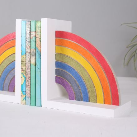 Solid wood bookend featuring rainbow on a white base.