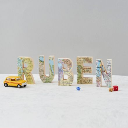 Wooden letters spelling out child's name - RUBEN - featuring Seattle map on each letter.