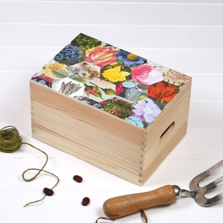 Handmade wooden seed storage box with patchwork print of flower images on lid.