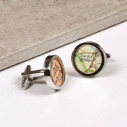 Silver cufflinks each showing a different map location.