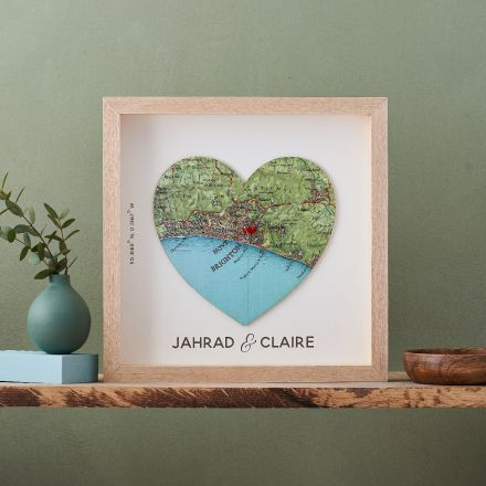 Map heart in red frame with a specific location marked with miniature red heart on the map.